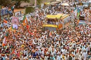 BJP president Amit Shah during a roadshow for an election campaign ahead of Karnataka Assembly elections in Badami.