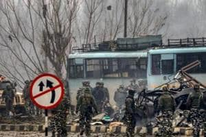 Security personnel carry out the rescue and relief works at the site of suicide bomb attack at Lathepora Awantipora in Pulwama district of south Kashmir, Thursday, February 14, 2019. At least 30 CRPF jawans were killed and dozens other injured when a CRPF convoy was attacked.