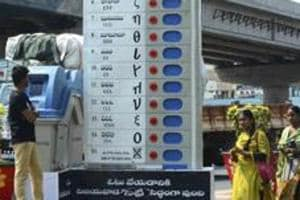 Pedestrians walk past a replica of an Electronic Voting Machine (EVM) installed by the Election Commission of India  in Vijayawada.