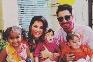 Sunny Leon poses with her family on Holi.