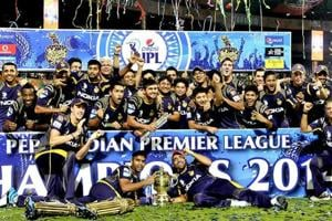Kolkata Knight Riders players celebrate with the trophy after their victory against Kings XI Punjab in the IPL final match at M Chinnaswamy Stadium, Bangalore.