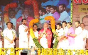 Prime Minister Narendra Modi is garlanded by BJP members during the Yuva Morcha meet, at Thekkinkad Maidanam, in Thrissur, Kerala, India, on Sunday, January 27, 2019.
