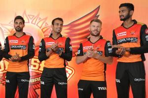 Sunrisers Hyderabad cricket team vice captain Bhuvaneshwar Kumar (L) and teammate David Warner (2R) pose with other players during a press conference in Hyderabad