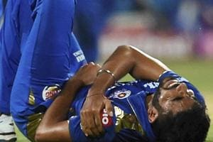 Mumbai Indians Jasprit Bumrah grimaces in pain during an IPL T-20 match against Delhi Capitals.