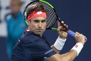 David Ferrer, of Spain, watches the ball before hitting a return to Alexander Zverev, of Germany.