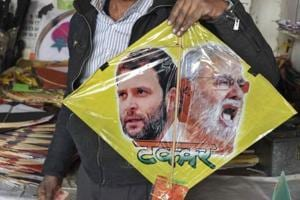 A kite maker shows a kite with images of Prime Minister Narendra Modi and Congress president Rahul Gandhi.