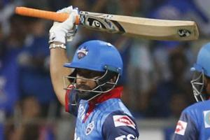 Delhi Capitals Rishabh Pant, left, raises his bat after scoring half-century against Mumbai Indians.