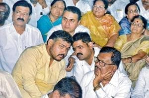 Vishal Patil (left, foreground) leans in to Pratik Patil in Sangli on Sunday, where Pratik announced that he is leaving the Congress party. Pratik and Vishal are brothers and Vishal might still contest the Sangli Lok Sabha seat.