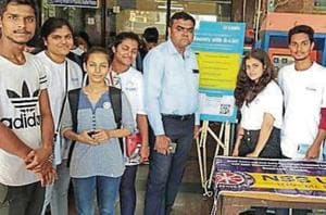 Students from RD National College, Bandra;  and Thakur College, Kandivli, at Virar station.