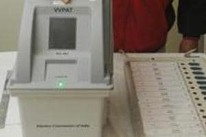 An election officer demonstrates how an EVM and a Voter Verifiable Paper Audit Trail (VVPAT) function.