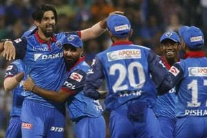 Delhi Capitals Ishant Sharma, left, celebrates with his teammates the dismissal of Mumbai Indians