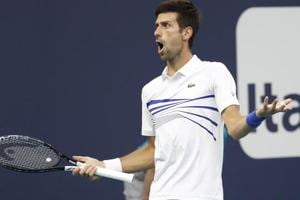 Novak Djokovic of Serbia reacts while arguing a line call against Federico Delbonis of Argentina.
