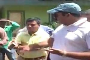 Watch: Goa Dy CM angrily knocks phone out of officer's hand, later apol...