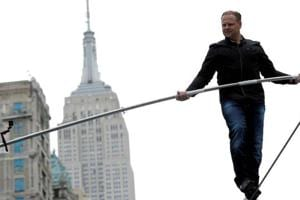 Siblings to walk 25 stories high across Times Square in death-defying stunt