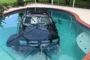 Florida driver accidentally steers car into swimming pool- Pics are making a splash