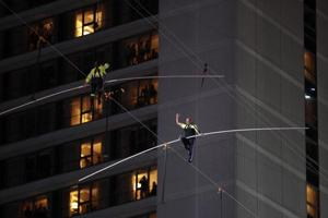 Siblings complete death-defying stunt, cross Times Square on high wire