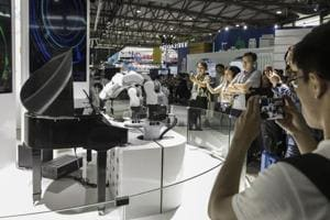 Debate: Robots, artificial intelligence will make humans jobless in 50 years