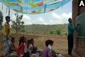 In scorching heat, students in this MP school study under makeshift tent