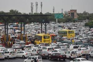 Waterlogging, traffic jams on roads after rain hits Gurugram