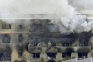 Firefighters work as smoke billows from a three-story building of Kyoto Animation in a fire in Kyoto, western Japan, Thursday, July 18, 2019. Kyoto prefectural police said the fire broke out Thursday morning after a man burst into it and spread unidentified liquid and put fire.