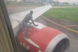Man climbs on plane's wing moments before takeoff. Watch bizarre video