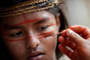 Photos: Brazil's indigenous Mura bring out war paint in fight for Amazon