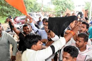 ABVPactivists protest against VBU vice-chancellor, deface his vehicle