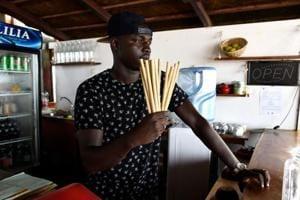 Photos: A Senegal restaurateur's lonely fight against the plastic tide