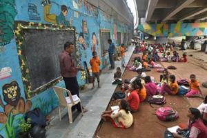 Under Delhi metro bridge, shopkeeper runs makeshift school for over 300 poor children