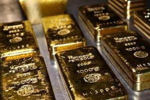 Gold edges higher on Brexit jitters, risk-on mood limits gains
