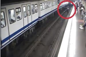 Woman busy on mobile falls onto tracks in front of train- Heart-stopping video captured