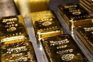 Gold hovers near one-month low after China, US agree on tariff roll-back