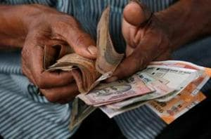 Rupee declines most in Asia as Moody's cuts India rating outlook