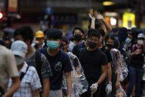 Masked Hong Kong protesters attempt to escape varsity campus