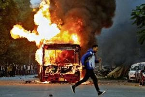 CAA fire rages in Delhi, buses torched; cops lathi-charge agitators
