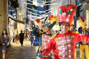 PHOTOS | Merry Christmas 2019: Costumed folk walk the streets of Brazil in an illuminated parade