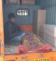 Brother-in-law Pavan Yadav with the body of passenger Rakesh Yadav, who hails from Gorakhpur and died at Pune railway station, taken to Sassoon General  Hospital in a luggage tempo on Friday.