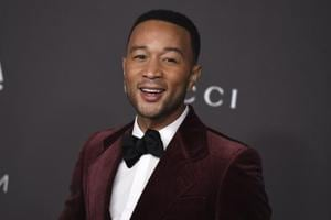 John Legend is nominated for a Grammy for best traditional pop vocal album with his holiday album, A Legendary Christmas.