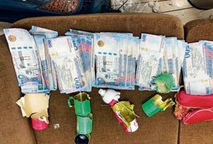 Man caught with rolled bundles of foreign currency in perfume cans at Delhi airport