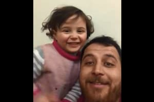 Syrian dad teaches daughter to laugh at sound of bombing, video is heart-wrenching