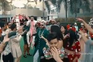 Bride can't hold back tears as groom surprises her by dancing to 'Saajanji Ghar Aaye'