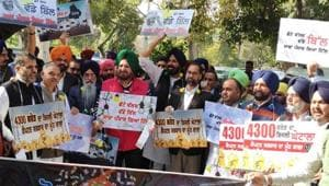 Shiromani Akali Dal members protest over power tariff issue outside Punjab assembly