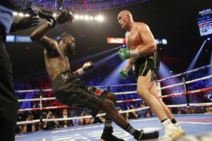 Tyson Fury forces Deontay Wilder's corner to throw in the towel, becomes new WBC Heavyweight champion