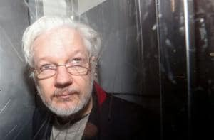 WikiLeaks' Julian Assange was handcuffed 11 times and stripped naked, says lawyer