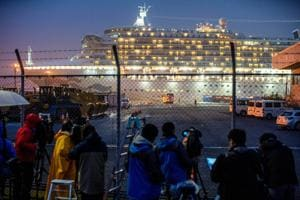 A bus arrives near the cruise ship Diamond Princess, where dozens of passengers were tested positive for coronavirus, at Daikoku Pier Cruise Terminal in Yokohama, south of Tokyo, Japan