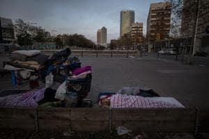 Photos: Coronavirus outbreak accentuates isolation of Spain's homeless