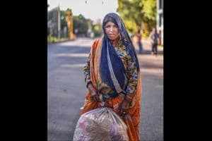 Photos: In Delhi, stirring portraits of migrant workers walking home