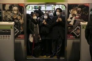 Photos: Masks, disinfectants-- the new normal for commuters now