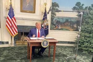 Pic of Donald Trump sitting behind 'tiny' desk leaves people with thoughts
