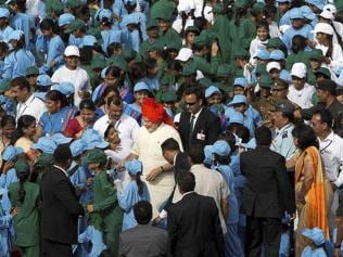 'People's premier' Modi breaks security ring to mingle with school kids